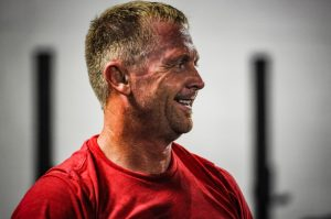 A picture of one of our CrossFit family members smiling.